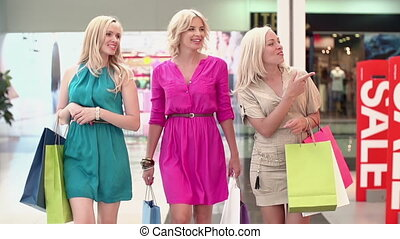 Addicted to Shopping - Slow motion of three lookers passing...