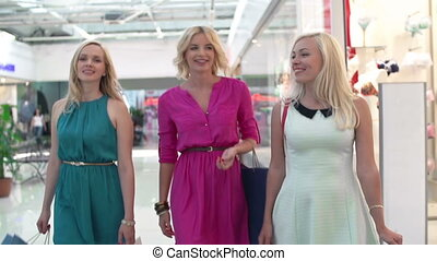 Overspending - Tracking shot of three stunners in shopping...