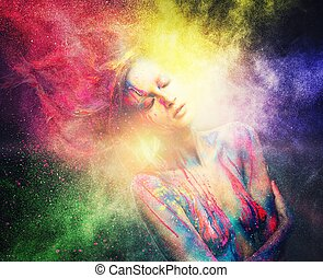 Woman muse with creative body art and hairdo in colourful...