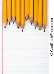 School Days - A row of wooden pencils sitting on a paper...