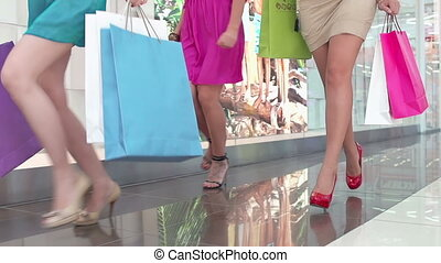 Sale Rush - Low angle of unrecognizable girls running with...