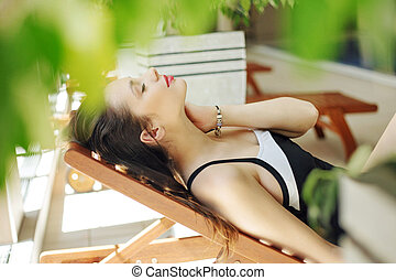 Gorgeous woman lying on the deckchair - Gorgeous lady lying...
