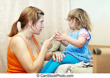 Woman scolds crying child - Woman scolds crying child at...