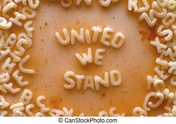 united we stand text made of food letters, tomato sauce with...