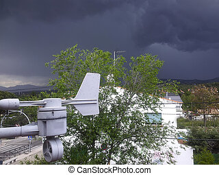 small home weather station in a storm