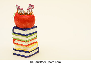 School Days - A stack of books with an apple sitting on top...