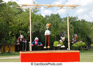 Puppets animals - puppets animals hanging on wooden slat...