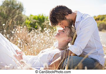 Attractive couple relaxing in the countryside on a sunny day