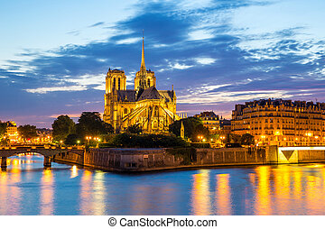Notre Dame Cathedral Paris - Notre Dame Cathedral at dusk in...