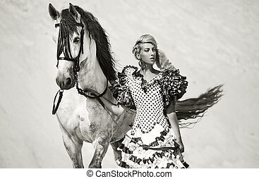 Portrait of the sexy woman with white horse