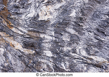 Folded rock - Close up of rock surface, gneiss with white...