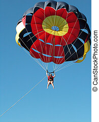 Parasailing at Punta Cana - Woman parasailing at Punta Cana...