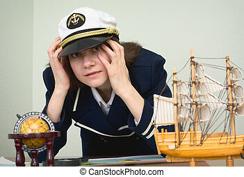 Scared girl in the form of sea captain