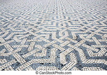 Tile brick floor in Lisbon Town Square, Portugal