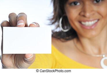 business card - woman showing her business card with focus...