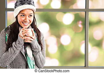 Girl drinking coffee - A shot of a beautiful asian girl...