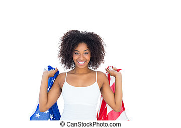 Pretty girl in white top holding american flag on white...