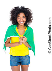 Pretty girl in yellow tshirt and brazilian flag smiling at...