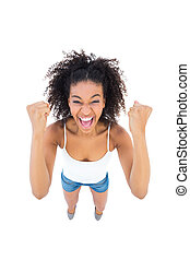 Pretty girl cheering at camera on white background