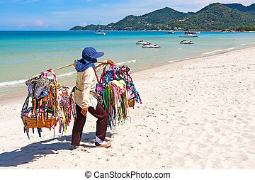 Thai woman selling beachwear at beach in Koh Samui,...