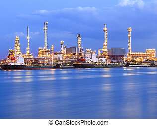 beautiful lighting of oil refinery industry plant beside...