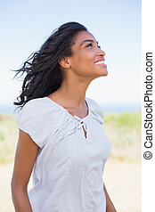 Casual woman smiling in the wind