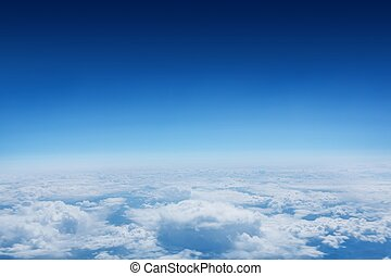 Blue sky over clouds at high altitude