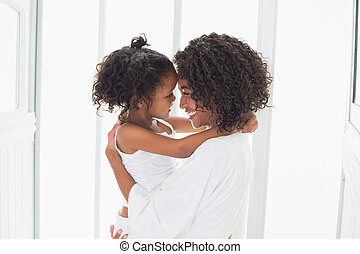 Cute little girl hugging her mother