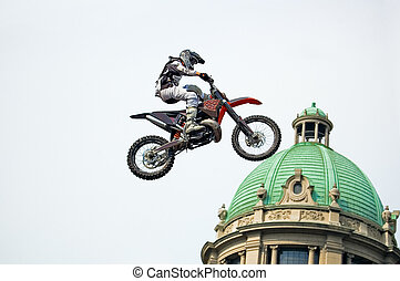 Jumpinghigh - Motocross rider performing extreme jump next...