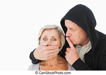 Older man silencing his fearful partner on white background