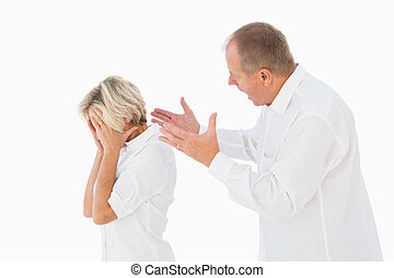 Angry man shouting at his partner on white background