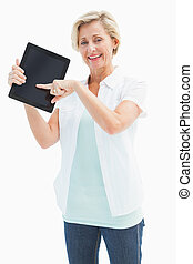Happy mature woman pointing to tablet pc on white background