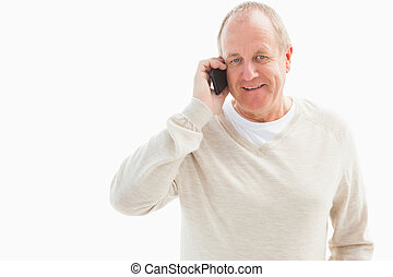 Happy mature man on the phone on white background