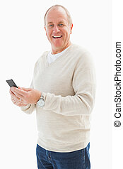 Happy mature man sending a text on white background