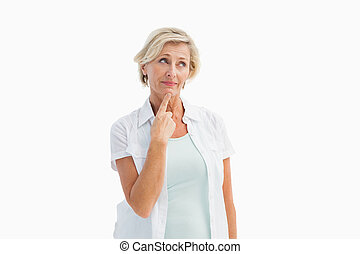 Mature woman thinking with hand on chin on white background