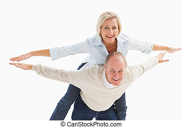 Happy mature couple having fun