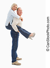 Happy mature couple having fun on white background