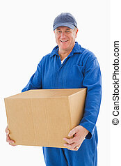 Happy delivery man holding cardboard box on white background