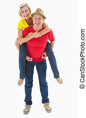 Mature couple joking about together on white background