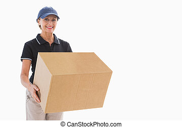 Happy delivery woman holding cardboard box on white...