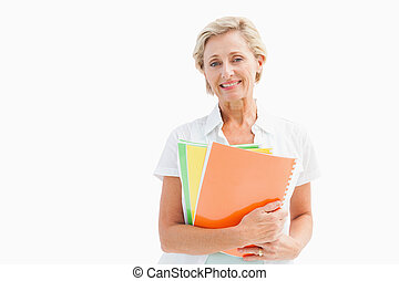 Happy mature student holding notebooks on white background