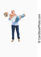 Mature man carrying his laughing partner on white background
