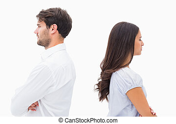 Upset couple not talking to each other after fight on white...