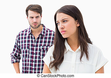 Angry brunette not listening to her boyfriend on white...