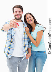 Happy young couple showing new house key