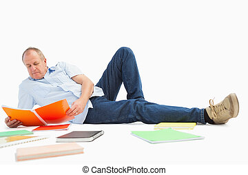 Mature student studying from notebook on white background
