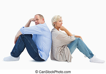 Upset mature couple not talking on white background