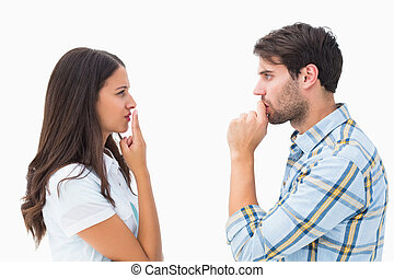 Upset young couple not talking on white background