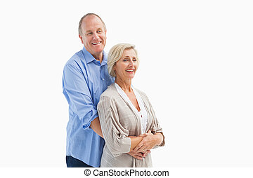 Happy mature couple embracing each other on white background