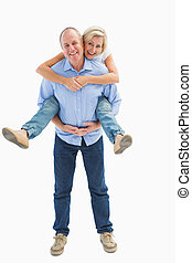 Mature man carrying his partner on his back on white...